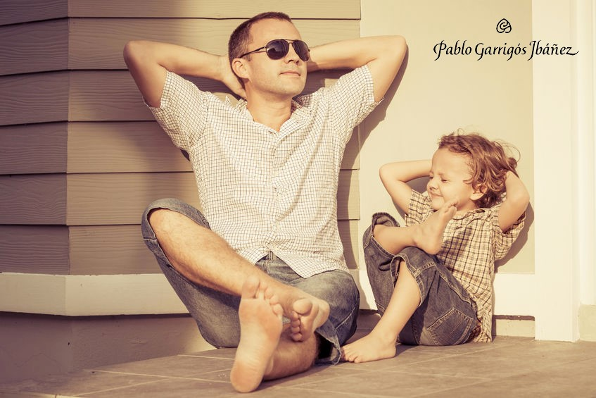33565210 - dad and son playing near a house at the day time